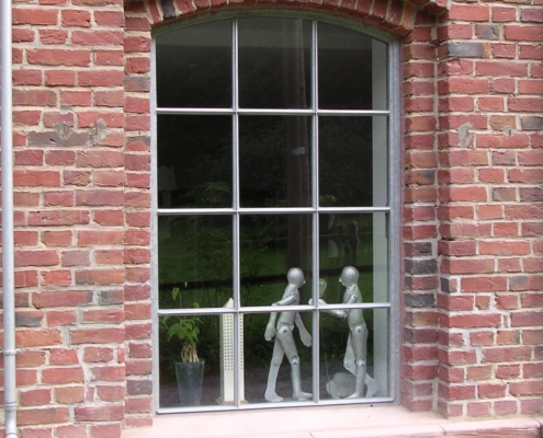 Stahlfenster mit Bogen und Sprossen verzinkt