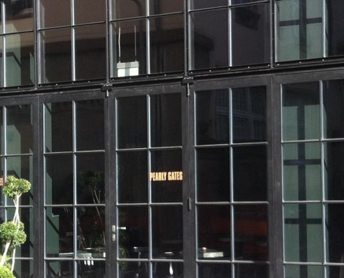 wärmegedämmte Stahlfassade mit Faltwand